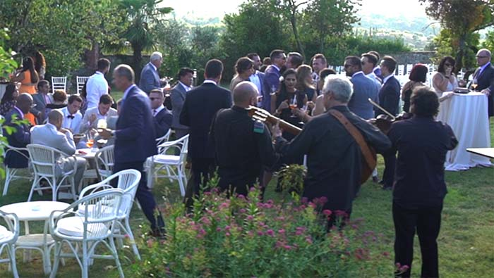 The Italian wedding folk trio playing during an aperitif in a villa in Tuscany